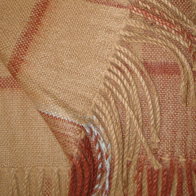 Warm Alpaca blend throw Isidro with a modern plaid pattern in brown-red