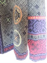 Cardigan in alpaca wool blend with a round neck, with embroidered details.