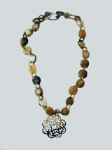PFL necklace with chains, buttons and flower design, made in bull horn.