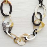 PFL necklace in a mix of large and small oval and round links made from polished buffalo horn.