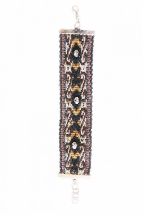 Traditional hand-woven artisan manta bracelet with woven pattern and silver details, connect with silver metal buckle.