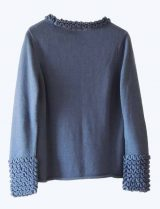 Knitted sweater blue in soft baby alpaca with a round neckline, cuffs and neck rushes pattern.