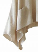 Fine knitted short poncho / cape short model, loose fitting soft baby alpaca performed with pockets on the front.