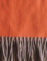 PFL HOME throw orange beige, in a blend of alpaca, wool and acrylic with fringes.
