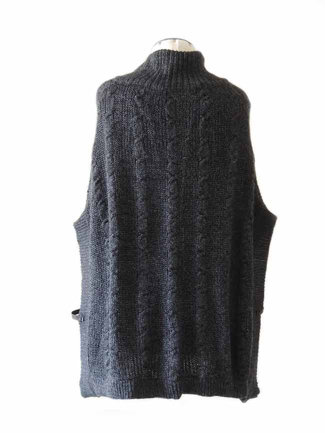 PFL knitted cape dark grey with lapel collar and a classic cable structure, rib structure at the edges and leather details.