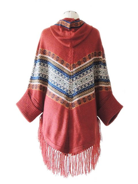 Cape / Poncho, hooded, short sleeved ethnic design and fringes at the bottom.