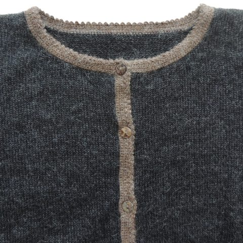 PFL Knitwear Women's classic cardigan, 100% natural soft warm alpaca wool artisanal made with crew neck and 2 pockets the right one with alpaca image and with with hand-crocheted cuffs. 7 button closure mother of pearl buttons.