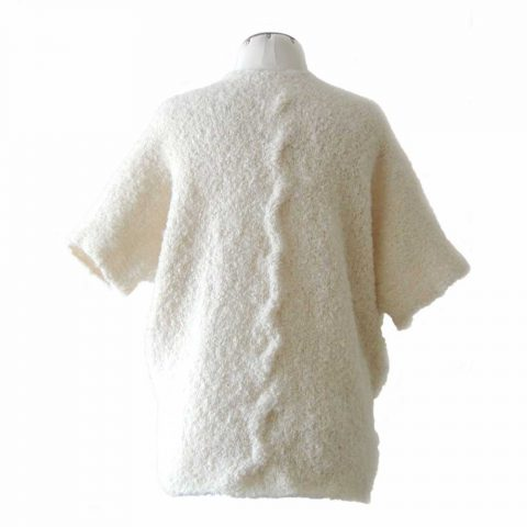 PFL Knitwear Kimono cardigan, hand knitted of verry soft alpaca boucle with short sleeves and 2 pockets at the frontside, color creme
