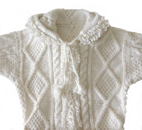 PFL knitwear Hand knitted cardigan solid color creme with zip closure, pockets, knitted loops, on the col and edges and belt in the same material.